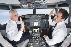 Germany, Bavaria, Munich, Pilot and co-pilot piloting aeroplane from airplane Stock Photos