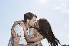 Spain, Majorca, Young couple kissing each other - stock photo