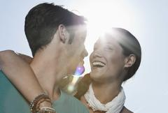 Spain, Majorca, Young couple romancing in sunlight, smiling - stock photo