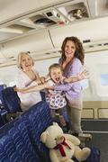 Germany, Munich, Bavaria, Women and girl having fun in economy class airliner Stock Photos