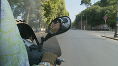 Lady on a scooter in Rome - 7 - slomo Stock Footage