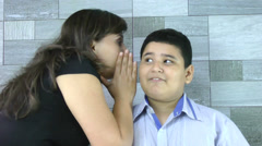 Mother whispers secret to her son Stock Footage