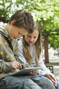 Stock Photo of Germany, Berlin, Boy and girl using digital tablet