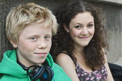 Teenage couple with headphone, smiling Stock Photos