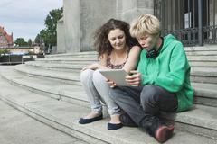 Stock Photo of Teenage couple using digital tablet