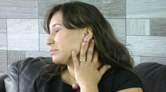 woman scratching neck and face with allergy skin problem - stock footage