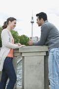 Stock Photo of Couple standing on bridge and talking
