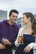 Couple drinking beverages - stock photo