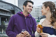 Couple drinking beverages Stock Photos