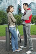 Stock Photo of Couple standing face to face in park