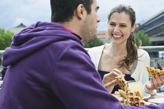 Couple eating food at cafe Stock Photos