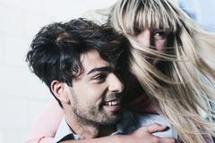Young couple smiling, close up Stock Photos