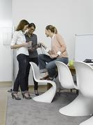 Stock Photo of Germany, Cologne, Young women using digital tablet