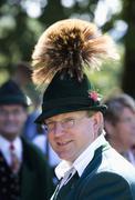 Austria, Salzkammergut, Land Salzburg, Young man wearing traditional costume and - stock photo