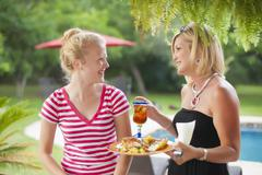 Stock Photo of USA, Texas, Mature woman and teenage girl looking at each other, smiling