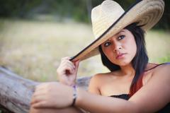 Stock Photo of USA, Texas, Teenage girl with sombrero hat, close up