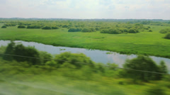 From the windows of high-speed trains on the fields and lakes (POV) Stock Footage