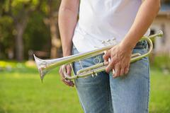 USA, Texas, Teenage boy standing with trumpet Stock Photos
