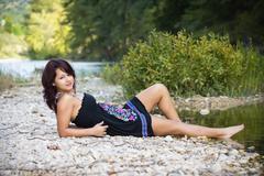 USA, Texas, muotokuva teini-ikäinen tyttö Frio River Kuvituskuvat