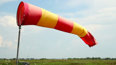 Wind sock in airport at daytime, cloudy windy weather, click for HD - stock footage