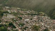 Clouds unveiling the city of Banos, popular tourist destination in Ecuador, Stock Footage