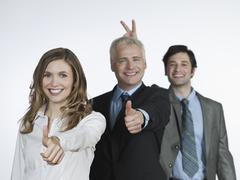 Men and woman showing hand sign, smiling, portrait Stock Photos