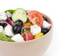 Fresh greek salad in clay bowl Stock Photos