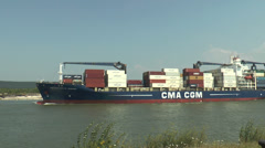 Loaded container ship (wide shot), River Seine, France Stock Footage