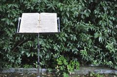 Germany, Bavaria, Musical note with stand and hedge in background - stock photo
