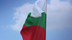 Bulgarian national flag waving on flagpole in blue sky. Bulgaria, click for HD Stock Footage