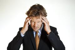 hurting businessman with migraine - stock photo