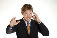 Clairvoyant businessman trying to control minds Stock Photos