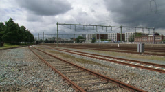 Dark clouds above empty railway emplacement Stock Footage