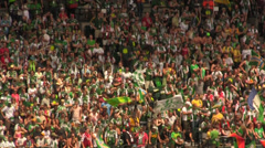 Soccer crowd waiving flags Stock Footage