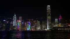 Ferry passes through Hong Kong Skyline at night Stock Footage