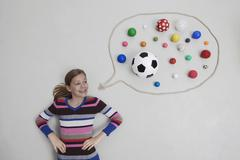 Girl with balls in speech bubble - stock photo