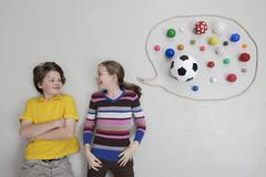Girl and boy with speech bubble, smiling - stock photo