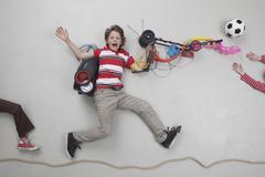 Boy with gadgets, portrait - stock photo