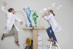 Boy and girl doing experiment - stock photo