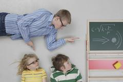 Stock Photo of Boy teaching speed of sound to children