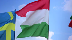 Flags of Sweden, Hungary, Bulgaria on flagstaffs., click for HD Stock Footage