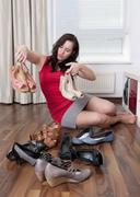 Germany, Berlin, Young woman choosing shoes Stock Photos