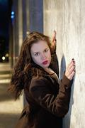 Germany, Young woman leaning against wall, portrait Stock Photos
