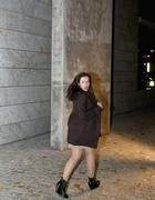 Germany, Berlin, Young woman running through street - stock photo