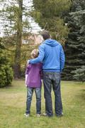 Germany, Leipzig, Father and son looking trees Stock Photos