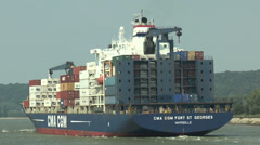 Loaded container ship (side & rear), River Seine, France Stock Footage