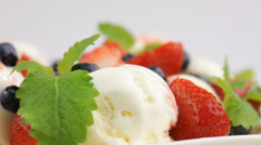 ice cream with fresh berries and mint - stock footage