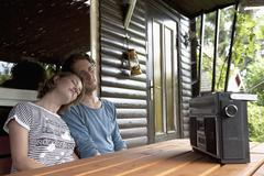 Germany, Hamburg, Man and woman listening to radio in cottage at allotment Stock Photos