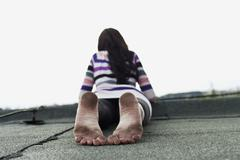 Stock Photo of Germany, Hamburg, Young woman lying on roof