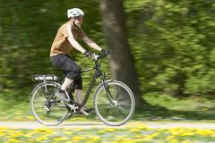 Stock Photo of Germany, Bavaria, Munich, Mature man riding electric bicycle